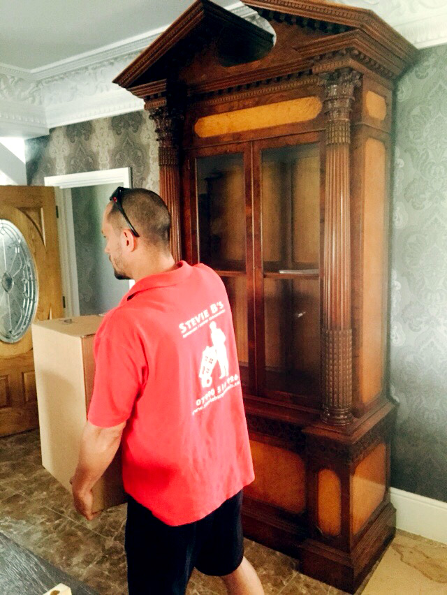 Brighton House Clearance and Cleaning service - removals man clearing items from house